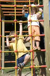 Children climbing rope ladder
