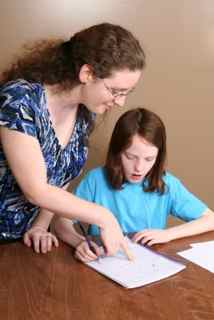 Mum helping daughter with schoolwork