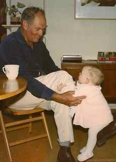 Baby bouncing on Grandad's knee