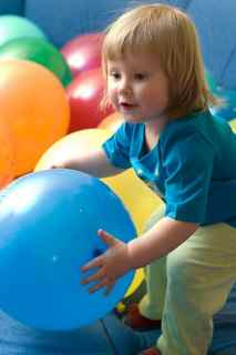Little girl with big ball