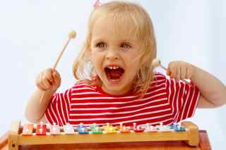 Preschooler playing a xylophone