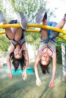 Two girls on play equipment