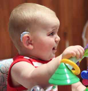 Baby with hearing aid